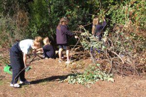 kids doing garden maintenance