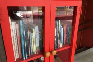 red cupboard with books inside