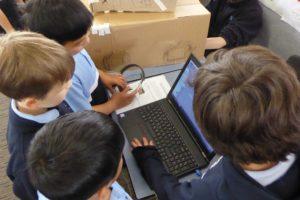 children around a laptop