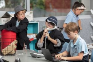 boys using phones and computer