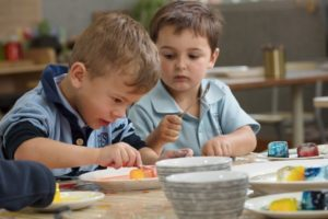 children with plate and ice