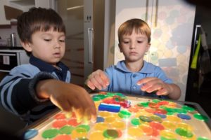 kids playing with colored circles